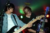 Picture of rock stars on guitar